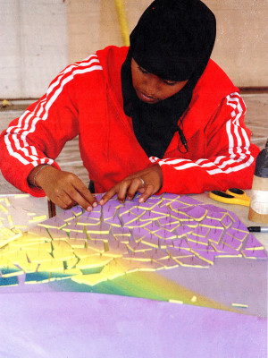 Saida-working-on-mosaic