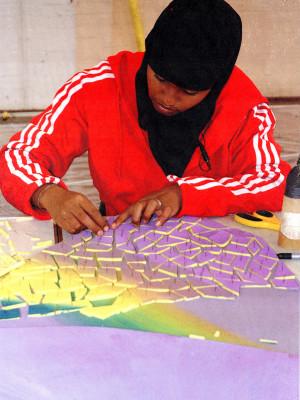 Saida-working-on-mosaic